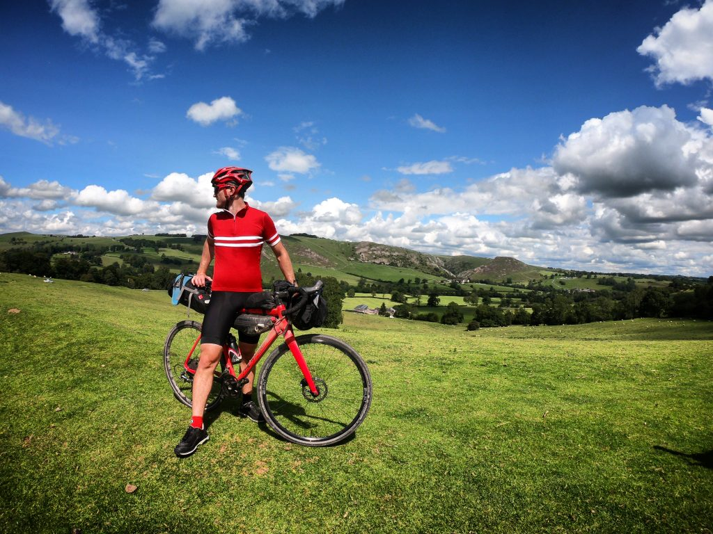 Rider, bike (Thompson R9300) and luggage (Alpkit) in front of the views over Ilam and Dovedale