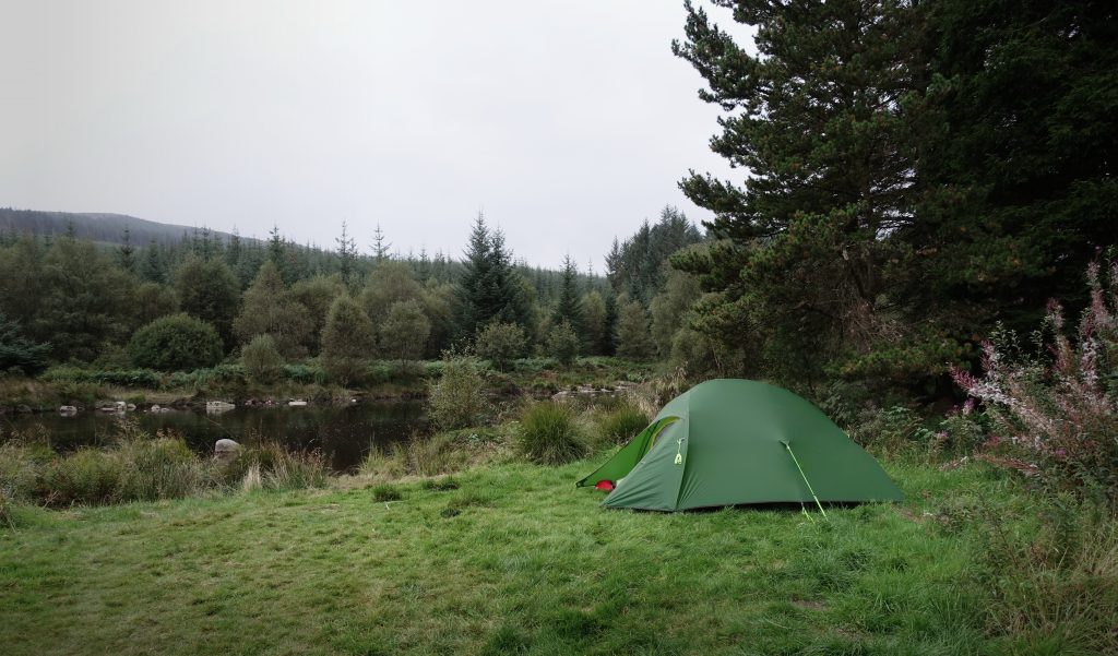 Tent pitched next to the river