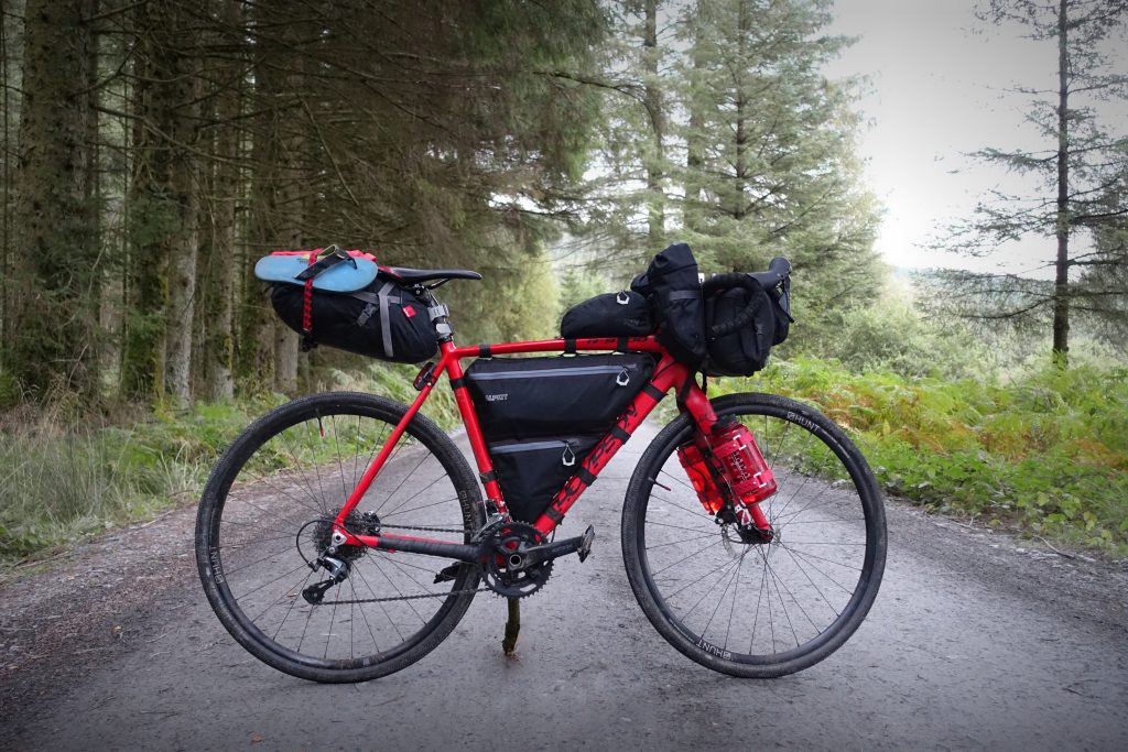 Thompson R9300 loaded up with Alpkit luggage on the Raiders Road